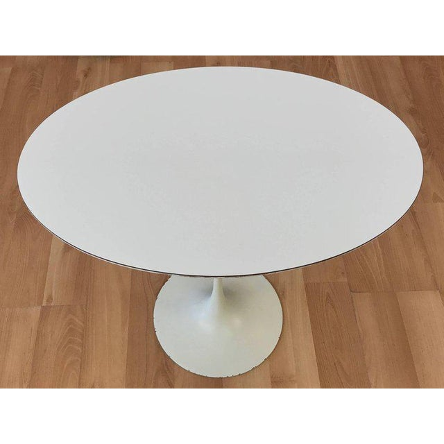 An early Pedestal Collection oval side table with laminate top by Eero Saarinen for Knoll. Designed in 1957 and more...