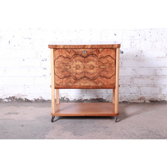 A unique and exceptional Art Deco burl wood bar cart. The cart features stunning burl wood grain, and it is finished on...