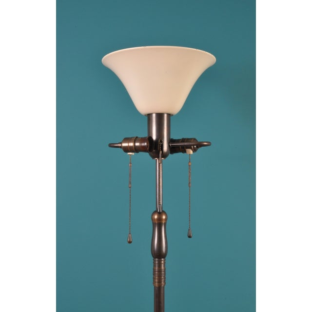 A large aged brass and bronze floor lamp from Swiss design and manufacturing firm, BAG TURGI, Zurich. A single socket...