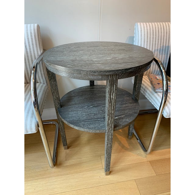 Round wood grain side table is a great addition to any room. Contemporarily made.
