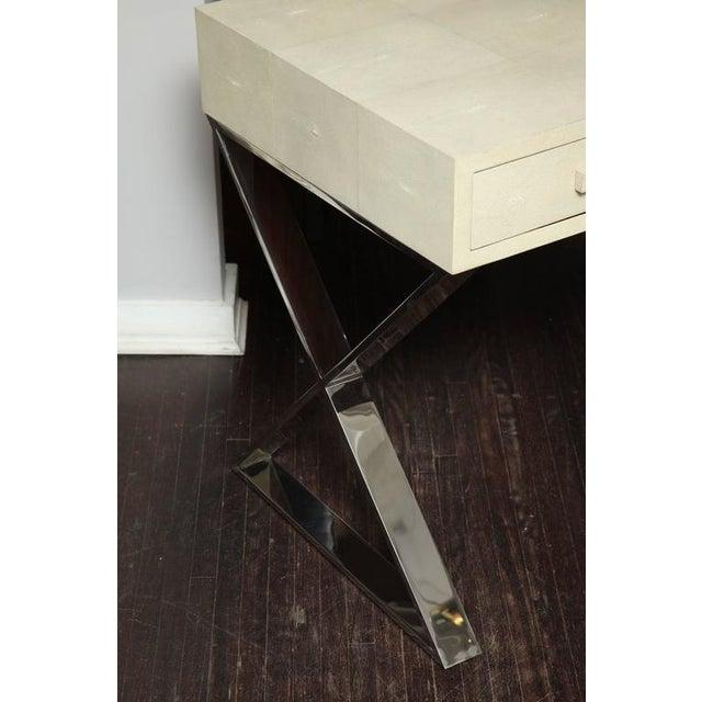 Genuine shagreen desk with polished chrome X-band base.