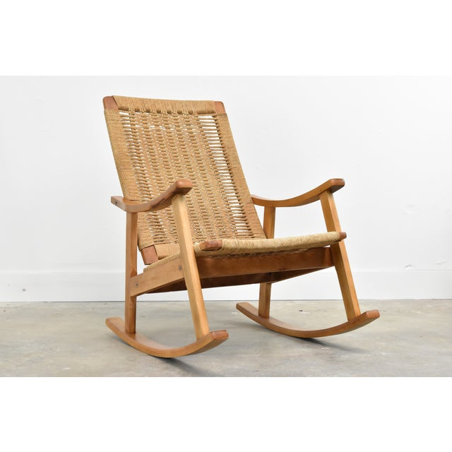 Classic mid century woven rope rocking chair in the manner of Hans Wegner. Made in Yugoslavia C1960s, this lovely vintage...