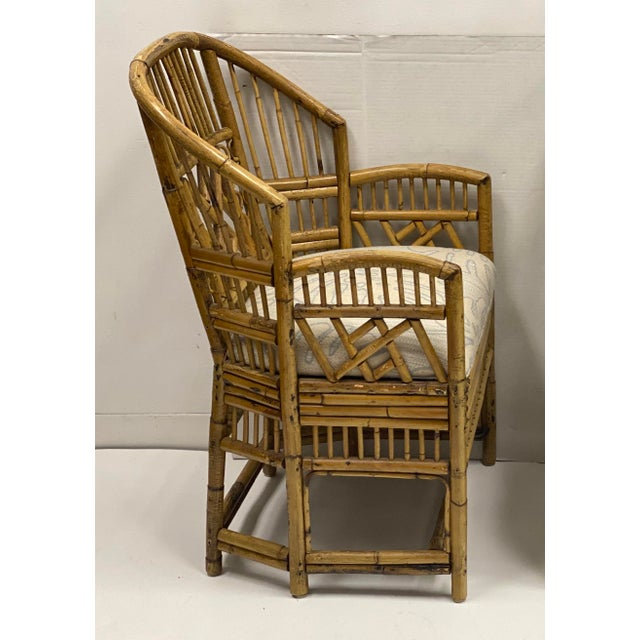 This is a vintage pair of bamboo Brighton chairs with new palm frond upholstery. They date probably to the 60s and are in...