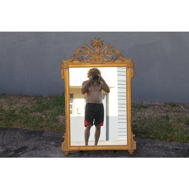 A beautiful 1940's highly detailed carved walnut Neoclassical style wall Mirror.