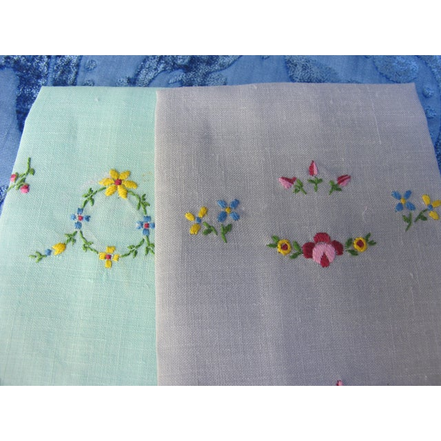 A pair of vintage starched and pressed linen hand towels, with a hand embroidered floral motif.