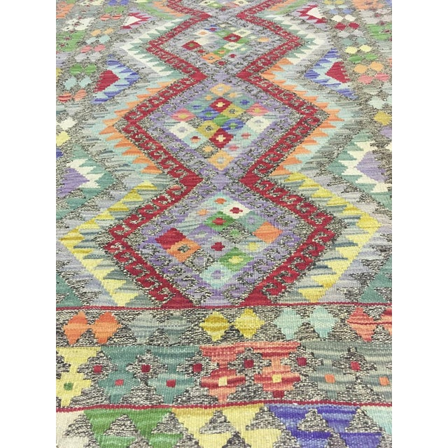 A beautiful traditional Uzbek kilim. It's brand new. This kilim is made of 100% wool, dyed with all natural dyes made from...