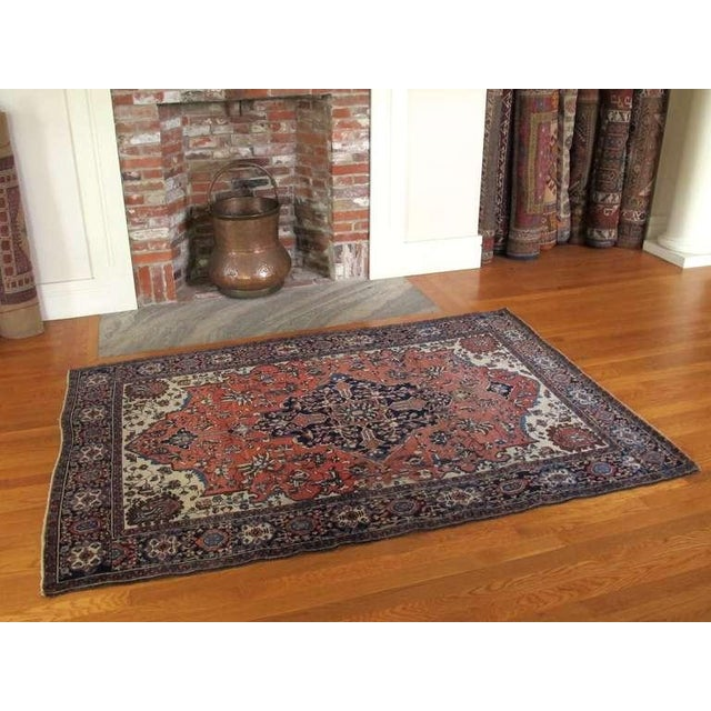 This Fereghan Sarouk carpet from central Persia blends formal design with a playful rendering using rich color and fine...