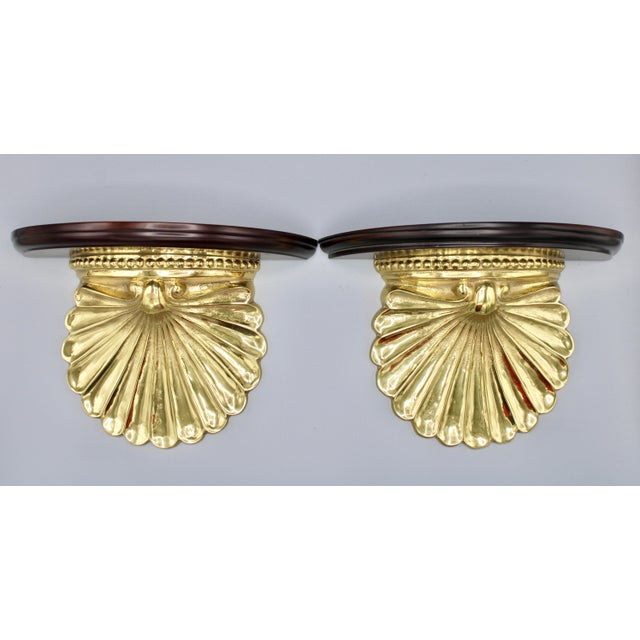 A fine pair of wood and brass coastal decorative wall shelves. Perfect for displaying a pair of oyster plates! There is a...