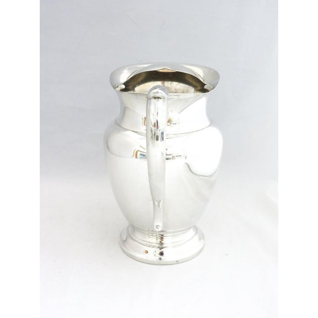 Silver Water Pitcher with Ice Shield which prevents ice dropping in glass. Very elegant addition to any table.