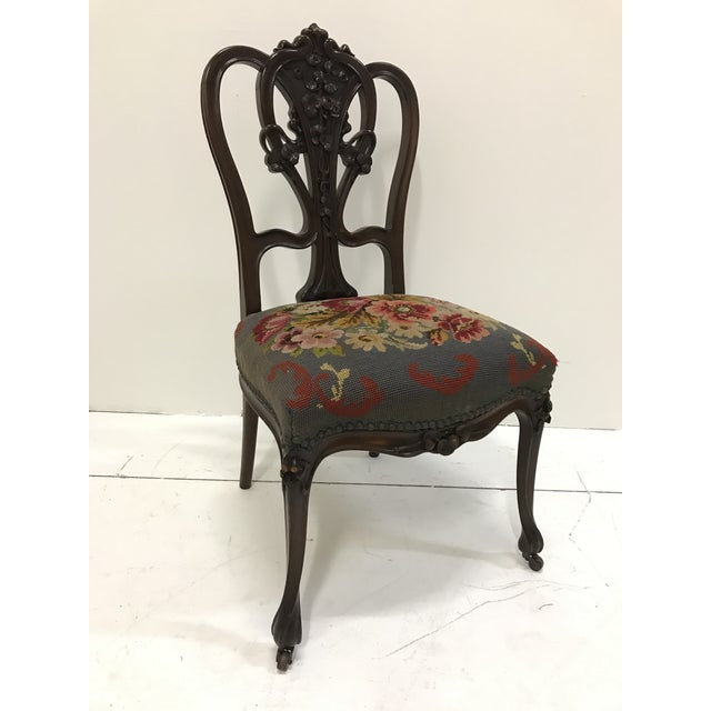Beautiful hand carved mahogany Art Nouveau side chair with details of waterlilies motif and classic whiplash lines. Seat...