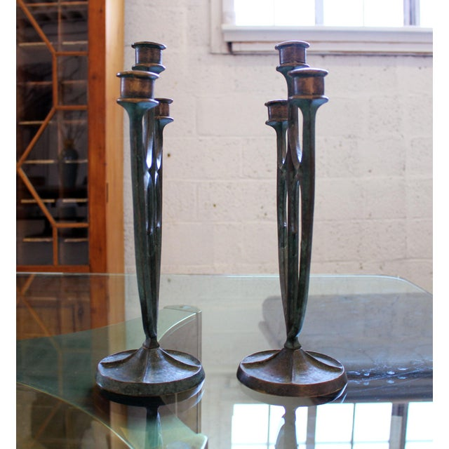 This set of three-arm arts and crafts bronze candelabra was made by the multitalented artist and sculptor Edward T. Hurley...