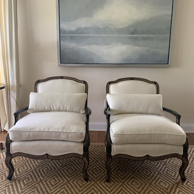 Simply chic. A pair of vintage Ebony finished chinoiserie chairs newly upholstered in a heavy weight oyster linen....