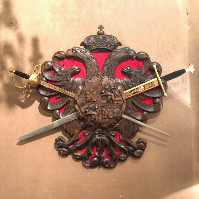 """Antique Carved Wood Decorative """"Coat of Arms"""" with Swords."""