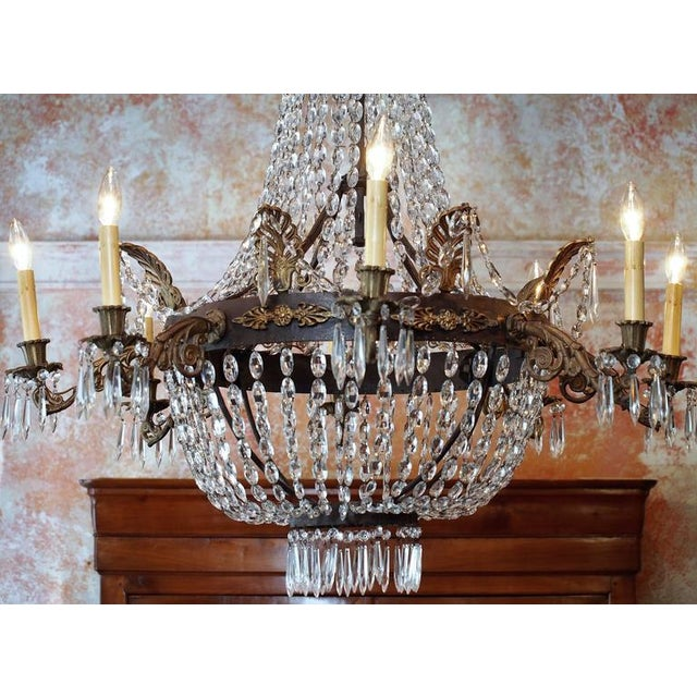 Antique French Empire crystal and bronze eight-light chandelier.