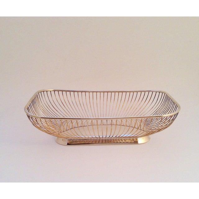 Vintage wire silver-plate bread basket in an unusual rectangular shape, recalling the style of Warren Platner. Marked F.B....