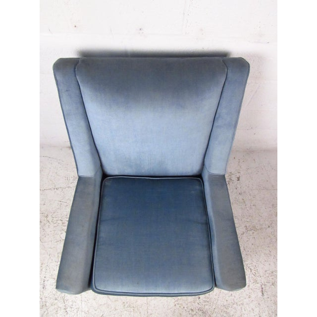Vintage-modern upholstered Paul McCobb style lounge chair, features removable seat cushion and tapered legs. The elegant...