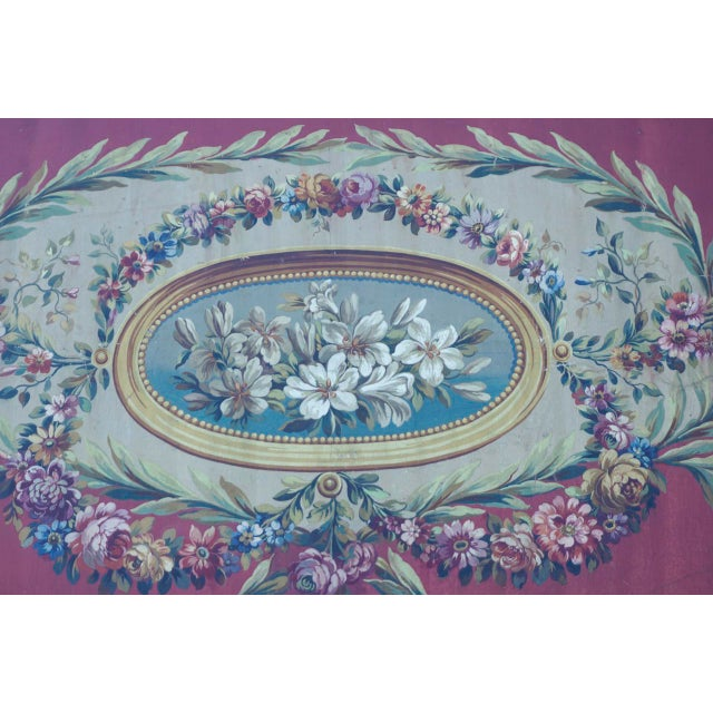 Beautiful French 18th century hand painted gouache on paper Aubusson carton featuring lilies in the center in an oval...