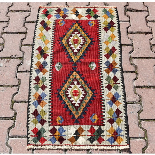 Vintage Turkish Kilim tribal geometric pattern hand-knotted kilim area rug . It has been professionally cleaned and washed...