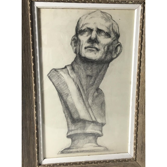 This is an Academy style drawing of a bust in charcoal on paper. Drawing is framed in a vintage frame; circa 1950.