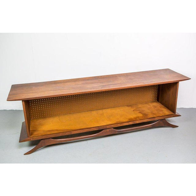 Sculpted studio cabinet, credenza or sideboard in walnut. This crafted woodworking piece has a Japanese esthetic.