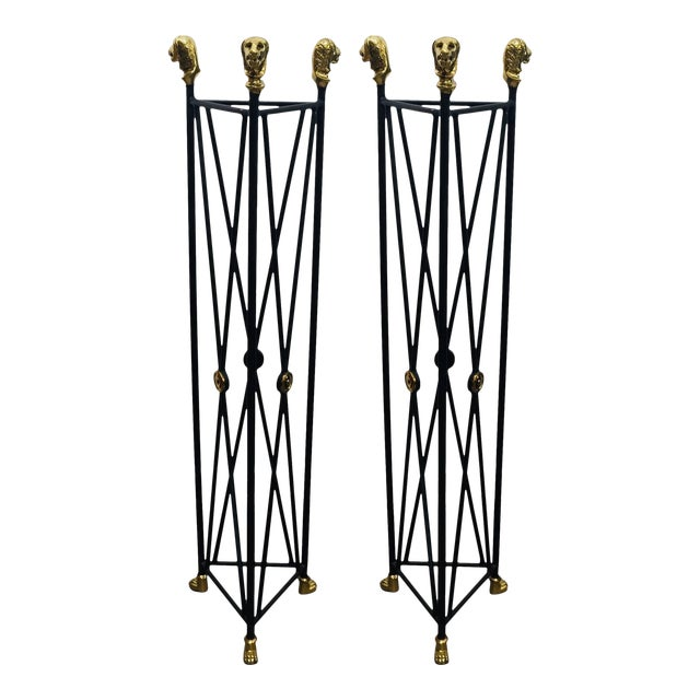 Neoclassical Style pedestals plant stand in black painted iron with brass lion's heads top and paw feet. Triangular shape,...