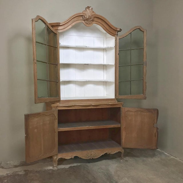 19th Century Italian Tuscan Bookcase features hand-rolled original glass panes (with a lovely subtle light green tint)...