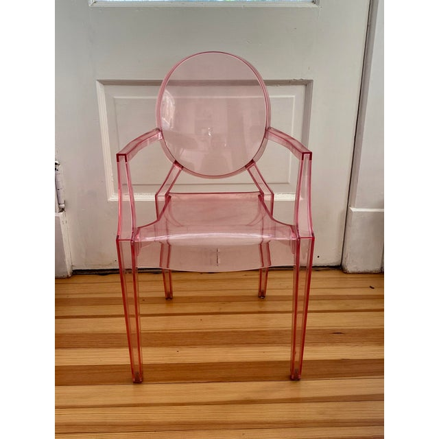 Very pretty chair in a pale pink. Signed. Scratches can be seen on the acrylic surface. Use for a child's room or as a...