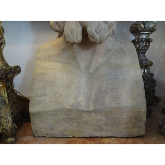 French terracotta bust/head (25 inches H) sculpture of a classical Greek figure. This fabulous monumental bust was created...