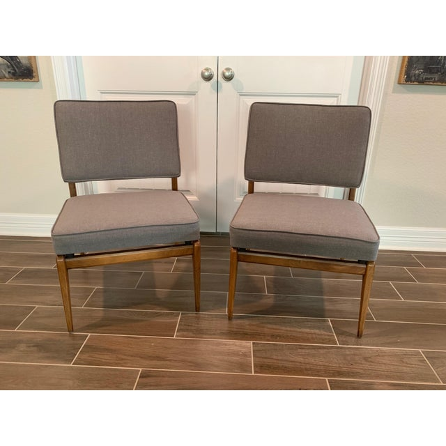 Stylish pair of mid-century modern chairs, attributed to Cassina brand, with walnut frames and new gray linen upholstery....