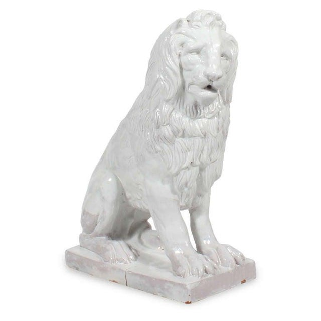 A pair of very regal seated Majolica lions, a white glaze over a terracotta base, great condition, with some of the...