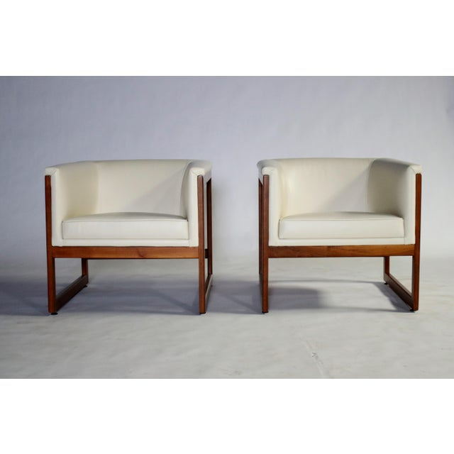 Pair of 1960s Milo Baughman floating or cantilevered cube shaped club chairs with solid walnut frames, newly upholstered...