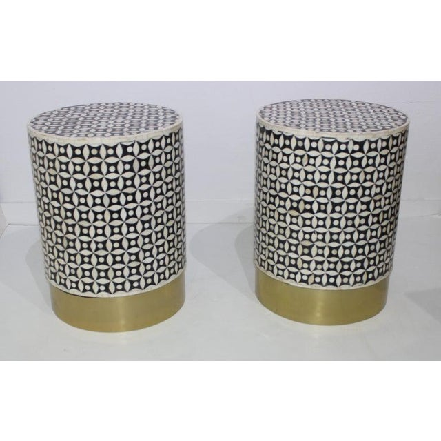 This stylish set of two handcrafted drum tables date to the 1990s and are fabricated in black and white tessellated bone...