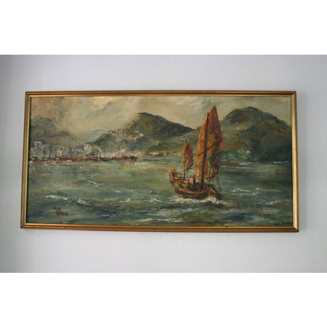 "Pretty vintage oil on artist board in gilt frame depicting a junk ship pulling into harbour and titled ""Hong Kong"". Signed..."