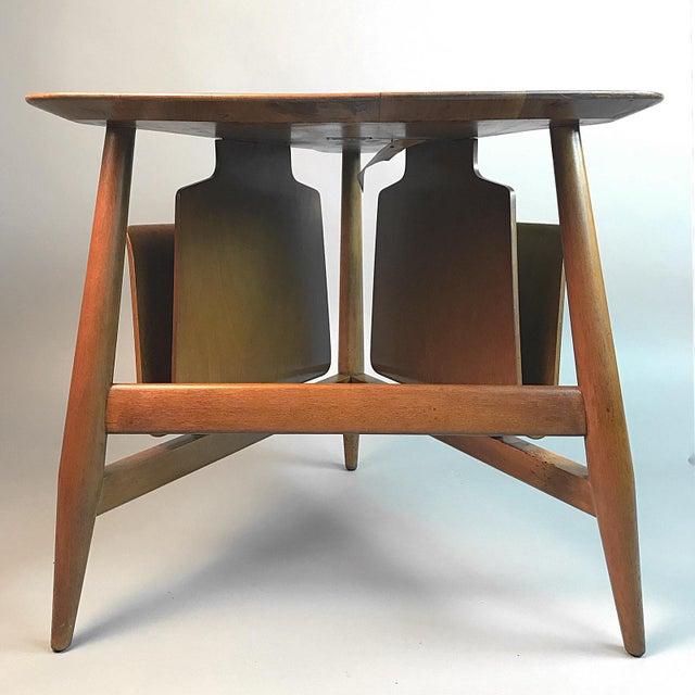 Stunning original condition Dunbar table. Model number #5313. Maintains original labels.