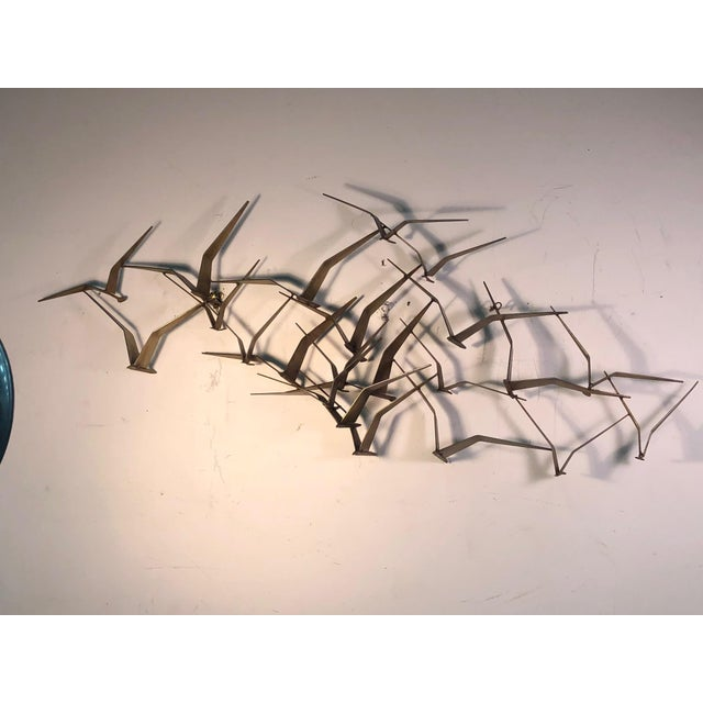 """Monumental Curtis Jere flying birds wall sculpture, signed. 1970's. Measures 54"""" by 23"""", 7"""" depth. Some wear appropriate..."""