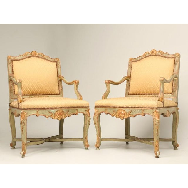 Magnificent pair Louis XV style Italian armchairs in complete original condition. These chairs have incredible carvings...
