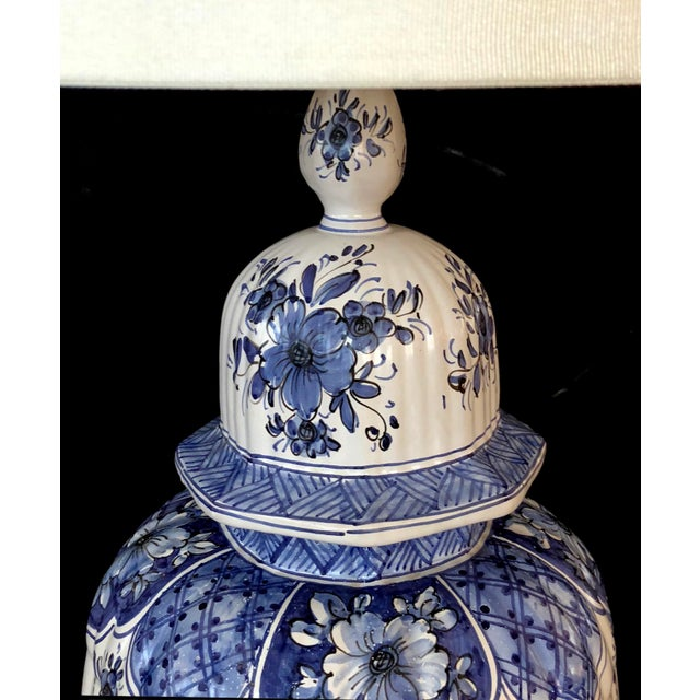 of impressive size, the lidded ginger jar with domed lid and tapering lobed body with underglaze blue decoration of...