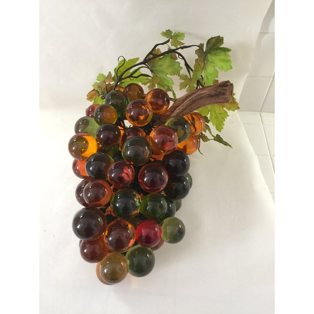 Fabulously large cluster of acrylic grapes with driftwood stem. This piece is super versatile and can be used in many...