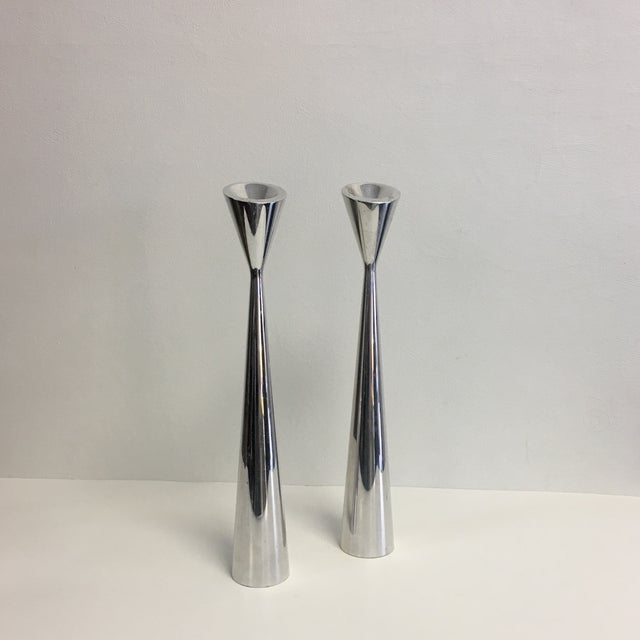 Pair of modernist polished metal candlesticks by Nambe. Great sculptural look.