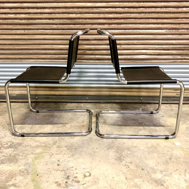 Pair of vintage Bauhaus black leather and chrome Mart Stam cantilever chairs. In excellent condition, the chairs have...