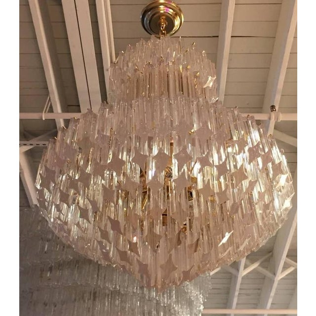 Stunning Mid-Century Modern Italian round chandelier by Camer. Each of the prisms are solid glass. They hang from hooks...