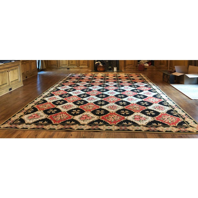 This is a classic petti-point woven wool rug from Stark Carpet. This rug is still available from the archived collection....