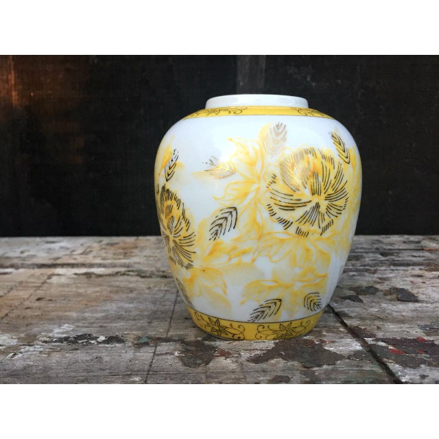 """This diminutive vase features a charming stylized floral motif c.1960s. The vase is marked on the underside """"Japan"""". The..."""