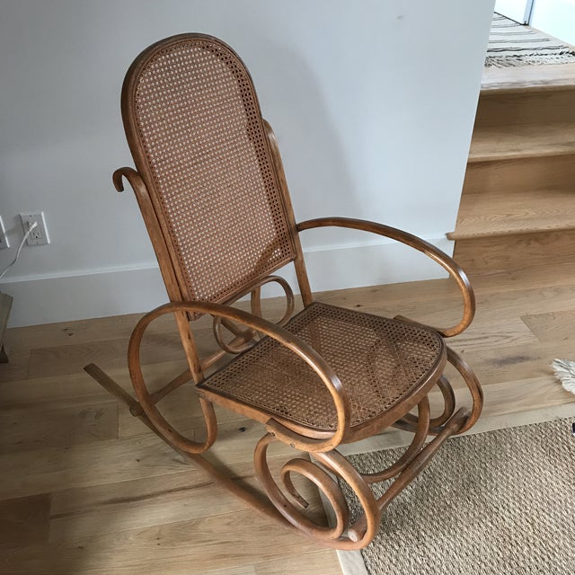 Fabulous bentwood Bohemian rocking chair with caning. Sturdy and very comfortable. Gorgeous smooth brown wood. Caning is...