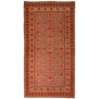 1920s Vintage Khotan Red and Blue Wool Rug - 4′4″ × 8′5″ For Sale