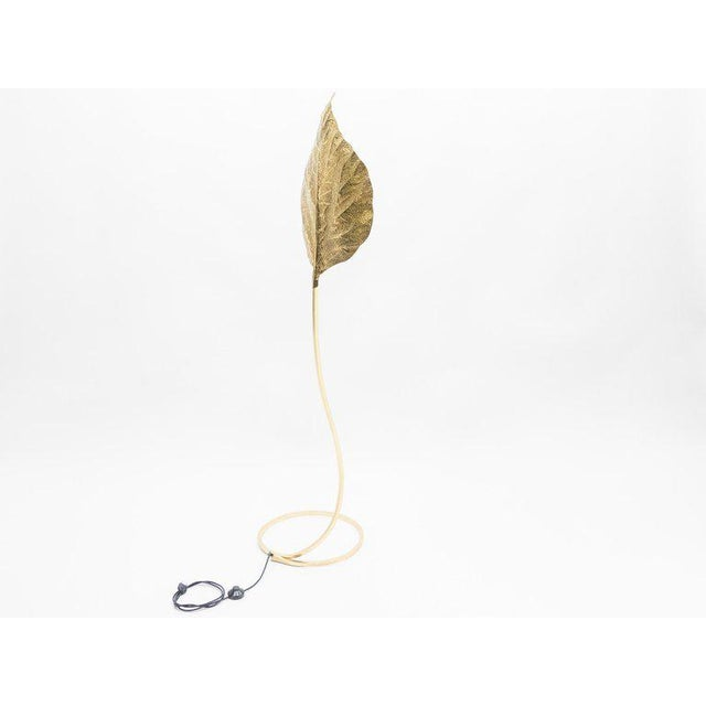 This iconic single leaf Rhubarb floor lamp by Tommaso Barbi was produced by Carlo Giorgi in Italy in the 1970s. The...