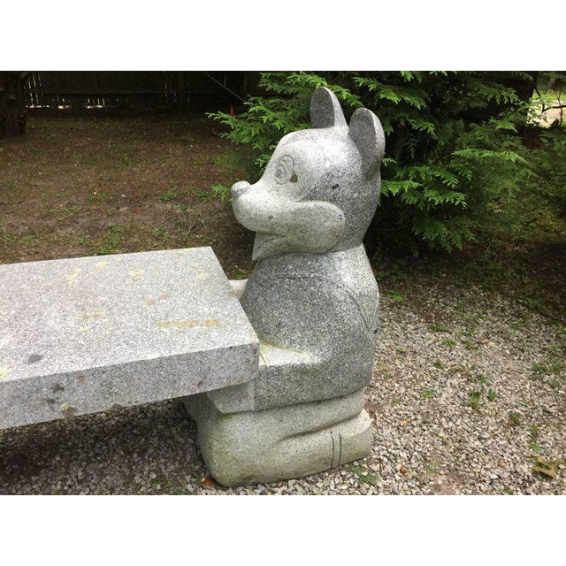 Exceptional details for this whimsical and large three-section granite carved bench or table. Calling all Disney fans!...
