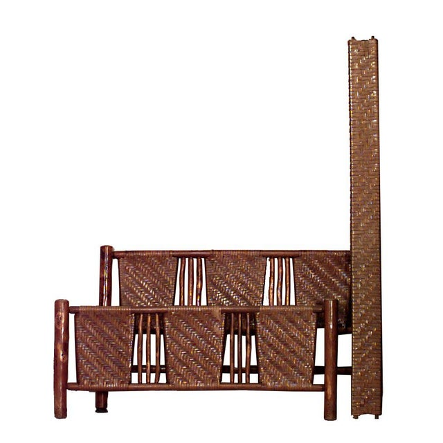 American rustic old hickory (20th century) full size bed with woven triple panel headboard and low footboard (headboard,...