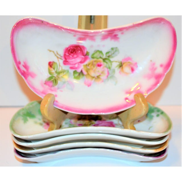 This is a beautiful set of Limoges German vintage small crescent and oval plates. They are floral in design with roses and...