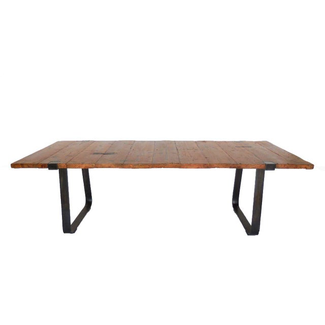 Table with reclaimed wood top with hand-forged iron mariposas and hand-forged iron base. Can be made in custom sizes and...